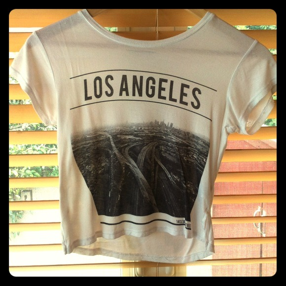 20% off Brandy Melville Tops - Brandy Melville Los Angeles Crop top from Leslie's closet on Poshmark