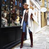 shoes,tumblr,brown boots,over the knee boots,thigh high boots,pants,blue pants,leather pants,top,floral,floral top,cape,white cape,winter outfits,winter look