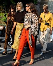 pants,orange,high waisted pants,leopard print,blouse,sandals,midi skirt,checkered,sunglasses,earrings,pumps