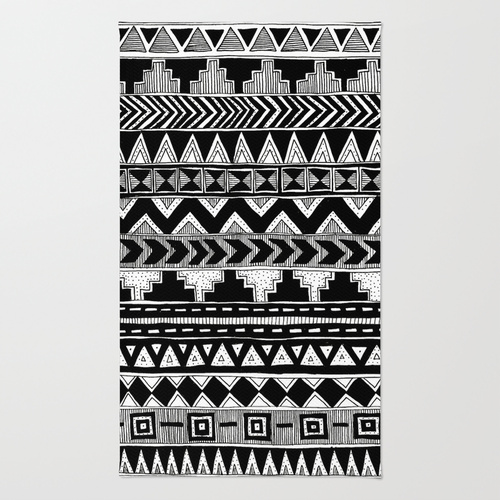 busy black and white aztec pattern rug by stacey muir