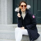 jacket,canada goose,blue coat,winter outfits,winter coat,sunglasses,denim,jeans,white jeans,turtleneck,black coat
