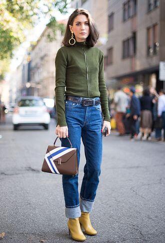 bag green top belt fashion week street style fashion week 2016 fashion week milan fashion week 2016 yellow boots yellow shoes boots high heels boots denim jeans blue jeans cuffed jeans top long sleeves printed bag handbag earrings