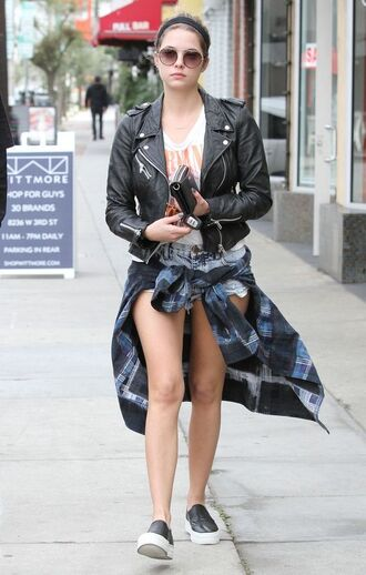 jacket ashley benson celebrity style celebrity actress shorts blue shorts denim shorts short shorts shirt tartan plaid shirt slip on shoes black shoes leather jacket black leather jacket black jacket top white top sunglasses