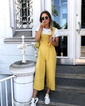 sunglasses,overalls,yellow overal,topw,hite top,bag,shoes