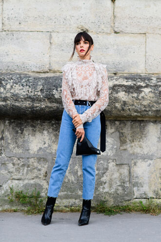 blouse fashion week street style fashion week 2016 fashion week paris fashion week 2016 lace top white lace top white blouse long sleeves belt denim jeans blue jeans boots black boots pointed boots high heels boots streetstyle