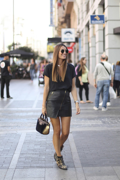 b a r t a b a c blogger top skirt shoes bag jewels printed boots printed ankle boots ankle boots black boots mini skirt black skirt black leather skirt leather skirt asymmetrical asymmetrical skirt t-shirt black t-shirt all black everything sunglasses handbag patent leather bag mini skirt and ankle boots