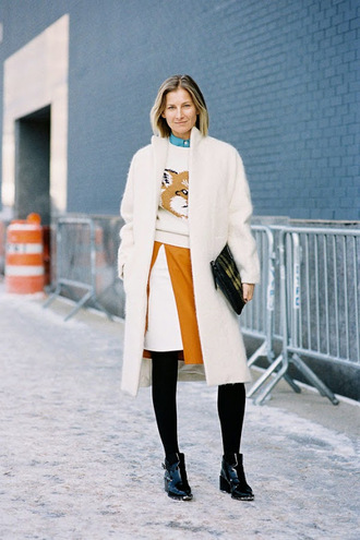 vanessa jackman blogger sweater coat shoes fox slit skirt winter coat fuzzy coat winter outfits white fluffy coat white coat skirt opaque tights tight printed pouch pouch ankle boots cold weather outfit white winter outfit patent boots white oversized coat