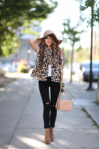 southern curls and pearls blogger scarf t-shirt shoes hat bag jewels make-up animal print white top floppy hat skinny jeans nude infinity scarf ripped jeans black jeans gucci ankle boots nude bag shoulder bag