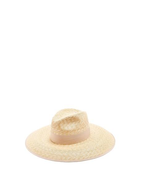 GUCCI Embellished straw hat in beige / beige