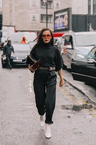 sweater black sweater belt bag bag sunglasses red sunglasses pants black pants boots white boots streetstyle turtleneck turtleneck sweater