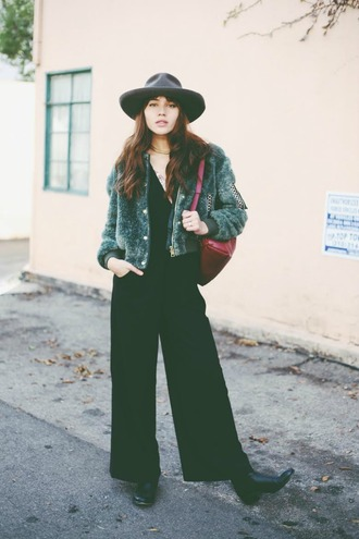 natalie off duty blogger jacket hat fluffy black jumpsuit jumpsuit blouse shoes