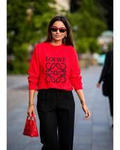 bag,handbag,red bag,mini bag,sweater,black pants,high waisted pants,wide-leg pants,sunglasses,earrings