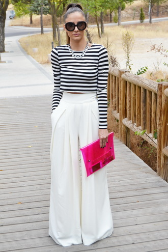 pants black and white stripe shirt white pleated pants pink purse sunglasses blogger