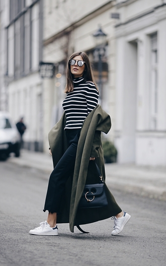 coat nyfw 2017 fashion week 2017 fashion week streetstyle green coat green long coat long coat sweater stripes striped sweater sneakers white sneakers low top sneakers pants black pants bag black bag sunglasses mirrored sunglasses