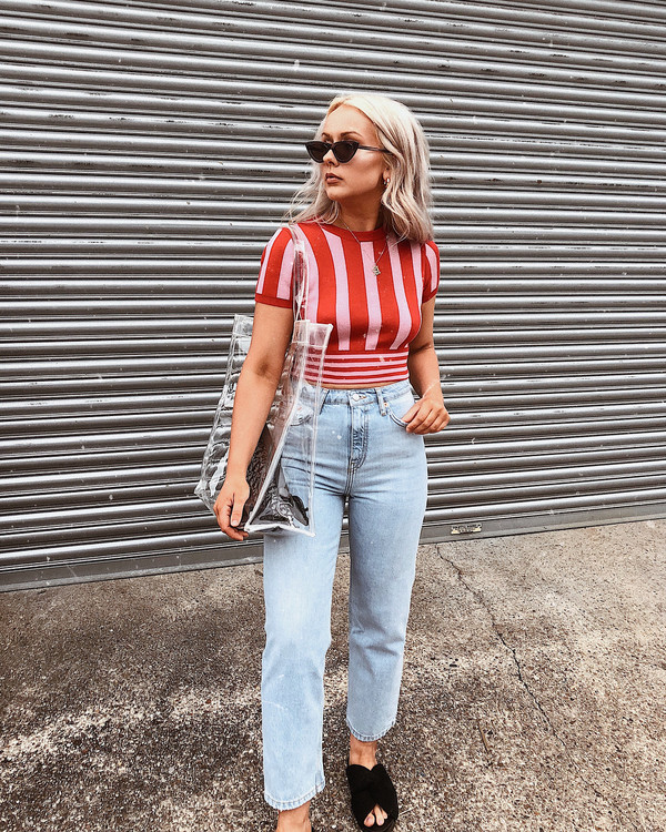 top red top pants jeans denim sunglasses bag