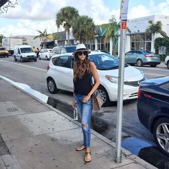 bag grey bag shiva safai celebrity jeans blue jeans ripped jeans flat sandals sandals black sandals top black top hat white hat