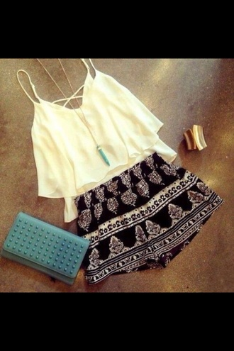 white top bag shorts singlet