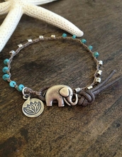 jewels,bracelets,cute,boho,elephant bracelet,elaphant,teal,silver,lotus,flowers,elephant,beaded