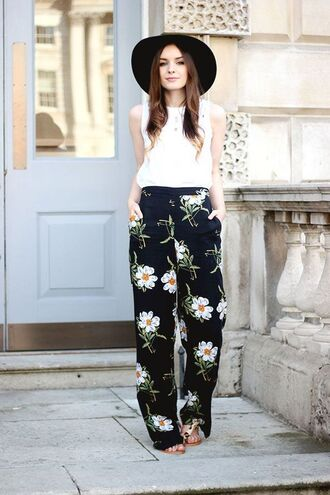 pants white top black hat floral flared pants blogger brown sandals