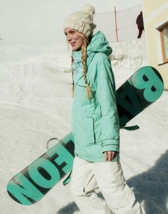 snowboarding turquoise girl winter sports pom pom beanie winter jacket jacket ski pants