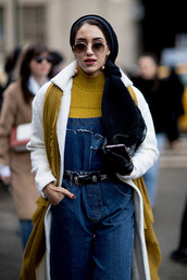 jeans,nyfw 2017,fashion week 2017,fashion week,streetstyle,overalls,dungarees,denim overalls,sweater,yellow,yellow sweater,mustard,scarf,coat,white coat,sunglasses,round sunglasses,00s style,belt