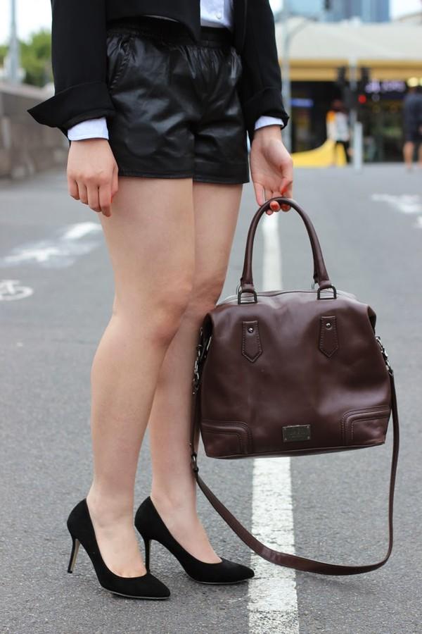 an odd girl shoes bag shorts shirt jacket