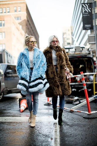 coat nyfw 2017 fashion week 2017 fashion week streetstyle blue coat brown coat fur coat big fur coat sweater white sweater grey sweater cropped sweater denim jeans blue jeans boots ankle boots black boots nude boots sunglasses cat eye yellow sunglasses