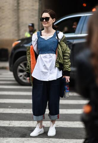 top nyfw 2017 fashion week 2017 fashion week streetstyle crop tops denim top blue top shirt white shirt jacket army green jacket sunglasses bomber jacket green bomber jacket khaki bomber jacket jeans denim blue jeans sneakers white sneakers