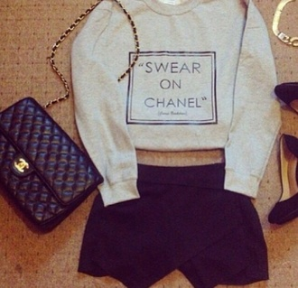 sweater skirt swear on chanel beige cropped bag high heels black high heels shorts chanel bag gold bracelet shirt quote on it swear on chanel grey oatmeal sweater chanel sweater t-shirt