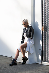 the haute pursuit,blogger,leather jacket,white skirt,cut out ankle boots,jacket,top,skirt,shoes,bag,jewels