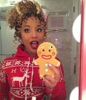 jadah doll,hairstyles,curly hair,hair accessory,red top,christmas sweater,Jadah Doll makeup,Jadah Doll nails