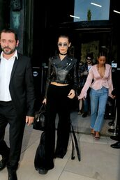 pants,jacket,biker jacket,crop tops,sunglasses,bella hadid,model,fashion week 2016,purse,bag,all black everything,givenchy bag
