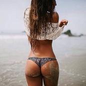 swimwear,slip,pants,bikini bottoms,bikini,tanga,string,string bikini,string bikini bottom,blouse,top,floral shirt,lace top,beach,cute,pattern,boho,cheeky,cheeky bikini,style,cheeky chic,cheeky bottoms,cheeky snake skin bottoms,cheeky shorts,brasilian bikini,swimwear printed,printed pants,print,black,coral,grey,black swimwear,swimwear two piece,cover up,thong