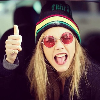 hat red yellow green cara delevingne