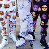 pants,emoji print,emoji pants,sweatpants,faces,stickers,smileys,white sweatpants,kiddchief,belt,cute,jeans,dope,100,swag,black 100 emoji pants,pajamas,trendy
