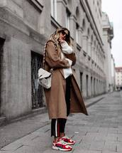 coat,long coat,wool coat,oversized sweater,sneakers,jeans,stripes,black jeans,sweater,shoulder bag,sunglasses