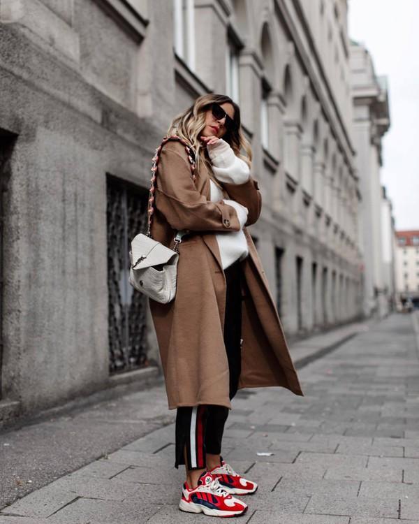 coat long coat wool coat oversized sweater sneakers jeans stripes black jeans sweater shoulder bag sunglasses