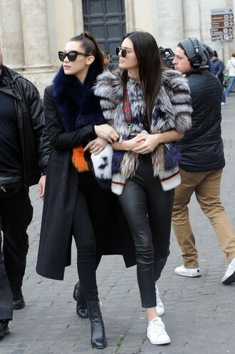 jacket fur fur jacket bella hadid coat model off-duty streetstyle sneakers pants sunglasses big fur coat fur coat cat eye kendall jenner celebrity style celebrity black sunglasses black coat long coat fur collar coat black leather pants leather pants black pants black jeans white sneakers low top sneakers black boots boots grey fur jacket