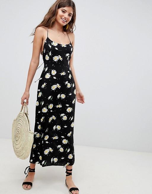 ASOS DESIGN Cami maxi dress in daisy print at asos.com