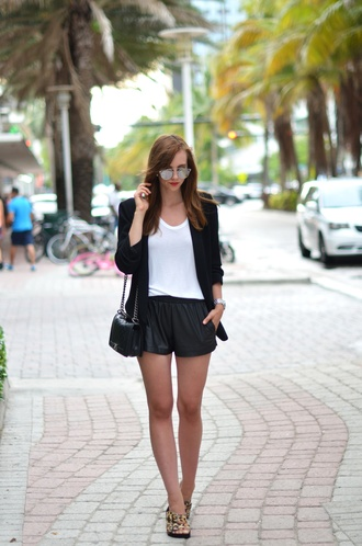 vogue haus blogger white t-shirt black shorts