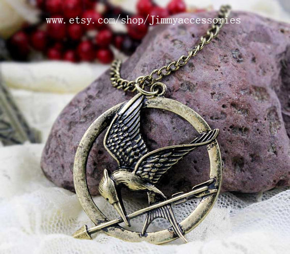 The hunger games pendant inspired mockingjay by jimmyaccessories aloadofball Images