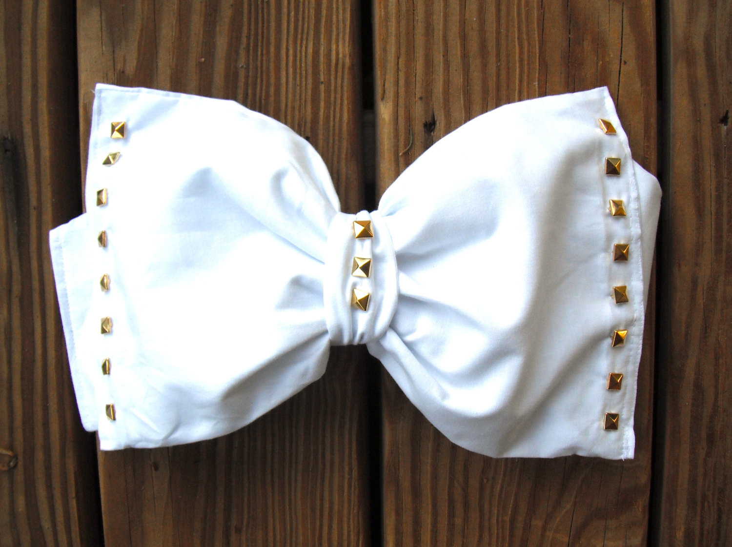 White bow bandeau with gold studs