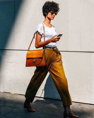 pants tumblr mustard bag brown bag t-shirt white t-shirt boots ankle boots sunglasses spring outfits streetstyle