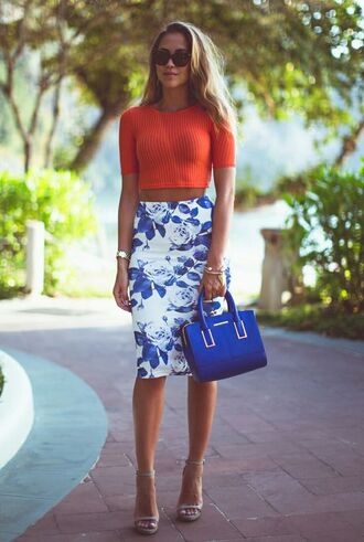 shoes barely there heels pencil skirt orange crop top nude barely there heels printed skirt floral skirt knitted crop top black sunglasses gold watch streetstyle blue handbag
