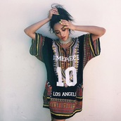 shay mitchell,shirt dress,african print,los angeles,dashiki,celebrity,celebrity style,accessories,jewels,necklace,statement necklace,jewelry,t shirt print,t-shirt,t-shirt dress,dress,boho,indie,sylish,alternative,team t-shirt,team shirt,team,black,white,red,shirt,top,dope,tribal pattern,summer,blouse,dimepiece,cute,swag,chic,streetwear