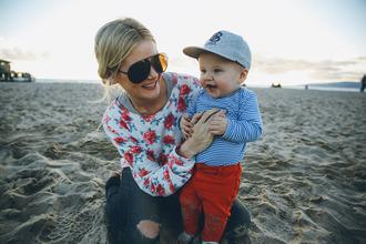 barefoot blonde blogger sweater roses kids fashion jeans sunglasses pants hat shirt