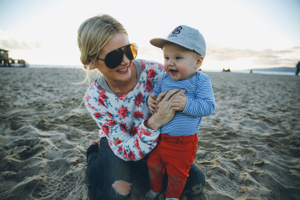 barefoot blonde blogger sweater roses kids fashion jeans sunglasses pants hat shirt