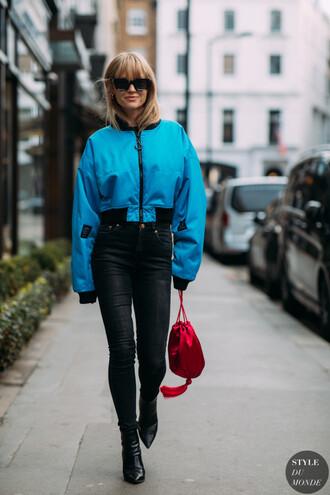 jacket bomber jacket jeans denim bag red bag shoes boots black boots sunglasses blue jacket