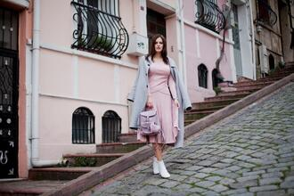 blogger top skirt the bow-tie shoes coat spring outfits pleated skirt booties ankle boots blue coat backpack pink top pink skirt