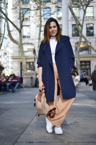 jacket white shirt navy blue trench coat pastel orange flared pants white sneakers blogger